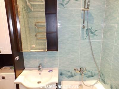 плитка с рисунком воды и дельфинов
