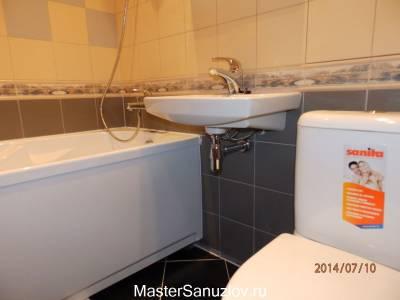 Ванная комната в серо-бежевом оформлении